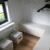 Meuble sur mesure à Wavre meuble tv meuble sous pente laqué et chêne massif tiroir aménagement chambre menuiserie sur mesure waterloo