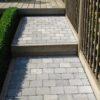 escalier en pierre avec du bois terrasse sur mesure wavre palissade buis plantation jardin de ville